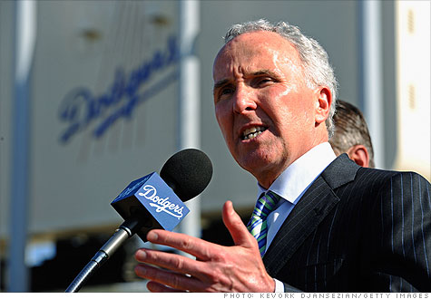 Frank McCourt's fight with Major League Baseball for control of his team has more to do with his debt than his divorce.