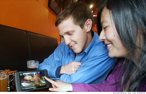 Diners check can order and tally bills with E La Carte's tablet system.