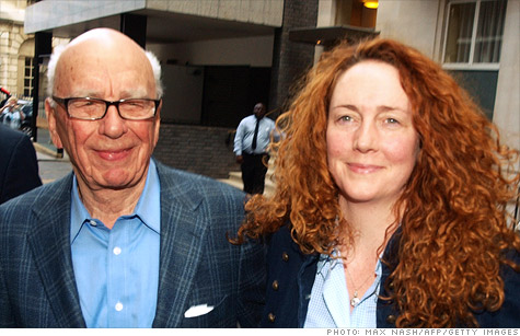Former News of the World editor Rebekah Brooks is arrested in connection with British police investigations into phone hacking and police bribery.