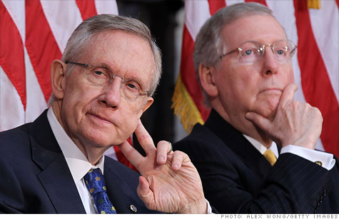 Moody's warned that a backup plan floated by Sens. Reid and McConnell should include spending cuts.