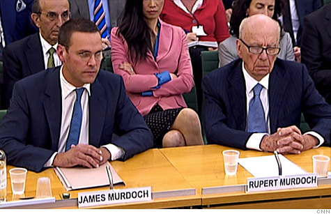Rupert Murdoch, right, his wife Wendi, center, and son James, left, and other Murdoch family members have lost $750 million from the News Corp. stock plunge.