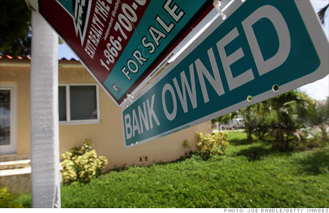 A Bank Owned sign is seen in front of a foreclosed home on September 16, 2010 in Miami, Florida.