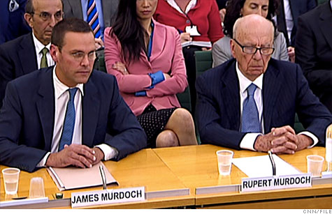 Rupert Murdoch and his son James Murdoch of News Corp. testify before the British Parliment in July. Both got big pay raises from the company, although James Murdoch returned his $6 million bonus.