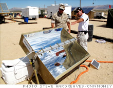 A Hoplite inventor shows a Marine what the combination solar power producer/hot water heater can do.