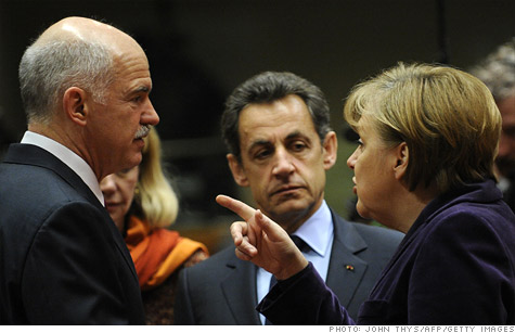 German Chancellor Angela Merkel (R) and French President Nicolas Sarkozy (C) talk with Greek Prime Minister George  Papandreou at an EU summit in February.