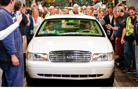 Canadian auto workers with the last Ford Crown Victoria to ever be produced.