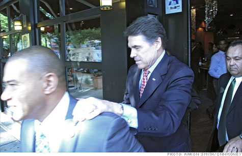 Gov. Rick Perry of Texas followed supporter Fernando Mateo out of his wife's restaurant in a quick visit to New York City.