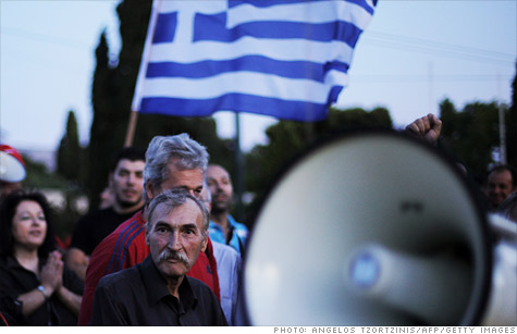 Taxi drivers protest outside the Greek Parliament in the center of Athens as the government struggles to cut spending and raise taxes.