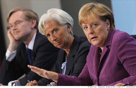 World Bank President Robert Zoellick, International Monetary Fund Director Christine Lagarde and German Chancellor Angela Merkel at a press briefing in Berlin.