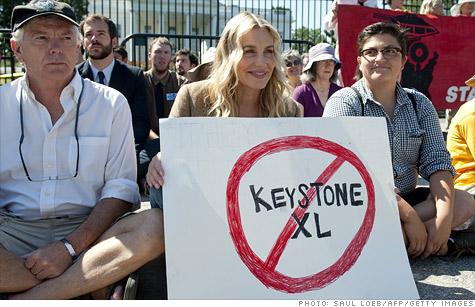 Actress Daryl Hannah protests the Keystone pipeline this summer. But jobs, money and oil will likely win out over environmental concerns as a decision on the controversial pipeline looms.