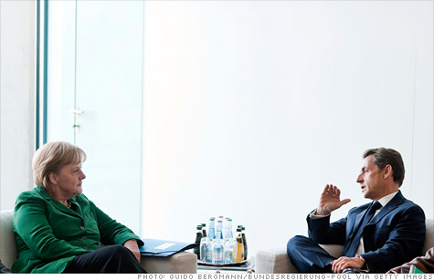 German Chancellor Angela Merkel and French President Nicolas Sarkozy discuss a 'comprehensive package' of measures to stabilize the euro currency.