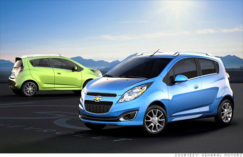The gasoline version of the Chevrolet Spark minicar, shown here, will go on sale in the U.S. next year. An all-electric plug-in version will go on sale in select markets in 2013.