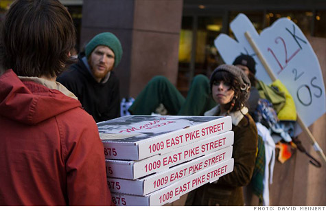 Big Mario's delivery driver brings hot pizzas to the Seattle Occupy Wall Street protest.