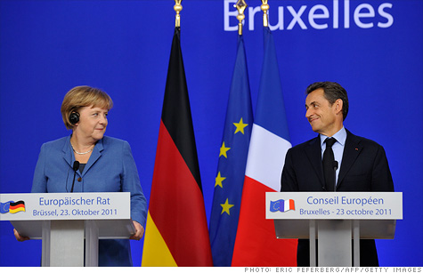 German Chancellor Angela Merkel and French President Nicolas Sarkozy hold a joint press conference about progress made to solve the eurozone debt crisis.