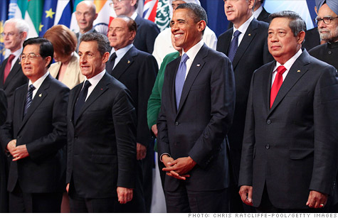World's top economic leaders stand together for a 'family portrait' at the G20 summit in Cannes.