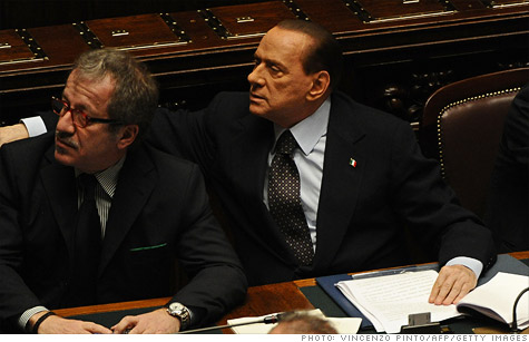 Italian Prime Minister Silvio Berlusconi (right) has vowed to step down, but that didn't keep 10-year bond yields from hitting record highs.