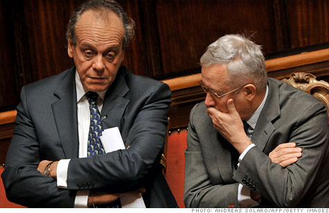 Nitto Palma and Giulio Tremonti  talk as Mario Monti, the frontrunner to replace Silvio Berlusconi as Italian prime minister arrives at the Senate in Rome on November 11.