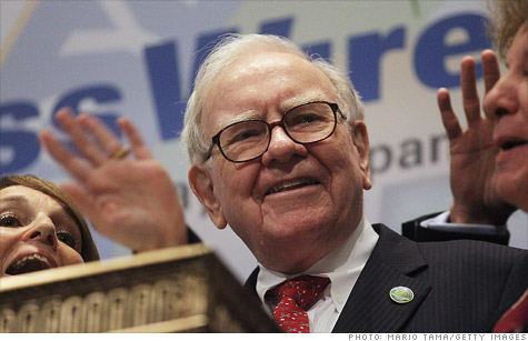 Berkshire Hathaway Chief Executive Warren Buffett, shown here ringing the bell at the New York Stock Exchange on Sept. 30, has reportedly bought $10.7 billion worth of IBM shares.