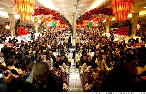 Shoppers jam Macy's flagship store in New York's Herald Square in the first minutes of Black Friday.