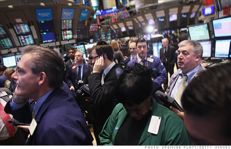 A new survey says pay on Wall Street and elsewhere in the financial sector will drop nearly 30% this year, the lowest levels since 2008.