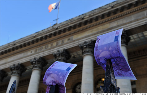 French bond auctions drew solid demand but nervous investors were too focused on downgrades to notice.