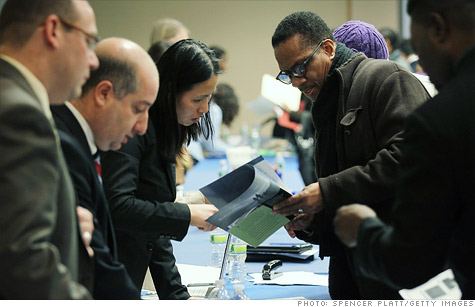 Job seekers speak with perspective employers at the New York Career Fair.