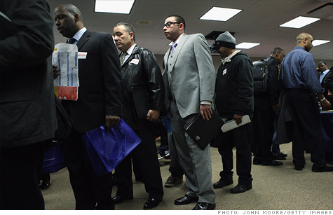 U.S. military veterans line up to meet potential employers during a veterans job fair in New York.