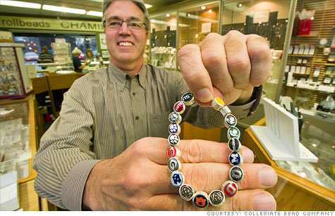 Dave Schowalter, owner of  Collegiate Bead Company, shows off his colorful sterling silver beads.
