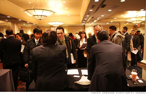 Seekers of gainful employment attended a job fair in Manhattan on Feb. 6. Their odds are looking up, as weekly jobless claims fell to a nearly four-year low.