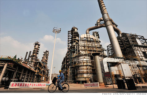 A worker rides a bicycle at a Sinopec oil refinery in China. State-owned enterprises, like Sinopec, account for roughly 40% of the country's GDP, according to estimates.