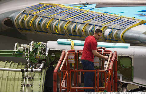 A Boeing employee works on an assembly line at the company's factory in Everett, Wash. New orders for nondefense aircraft and parts plummeted 19% in January.