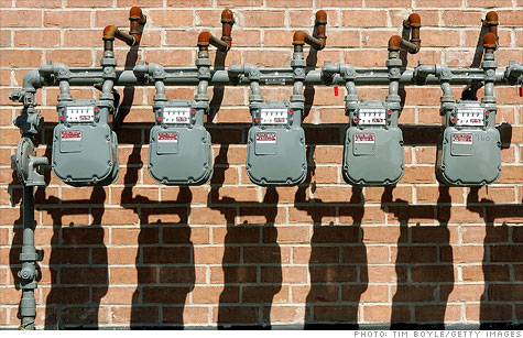Natural gas meters outisde a residential building in Illinois. Analysts see prices dropping below $2 as slack demand and rising output lead to a supply glut.
