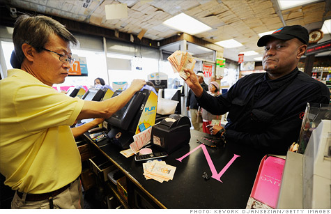 Mega Millions player Milton Smith showed off his lottery tickets in Hawthorne, Calif. on Thursday. He spent $1,080 on tickets, in the hope of scoring the $640 million jackpot.