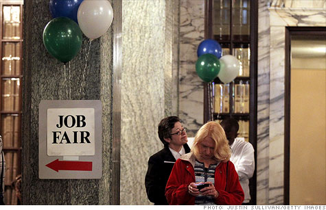 Job seekers wait in line to enter the San Francisco Hirevent job fair at the Hotel Whitcomb on March 27, 2012.