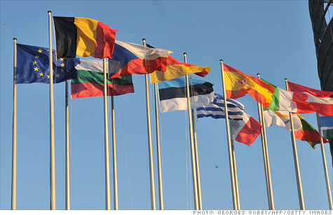 The outlook for global growth is improving but Europe's debt crisis and a potential spike in oil prices remain big risks.