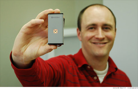 Xandem founder Joey Wilson shows off the company's motion-detecting sensor nodes.