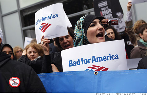 Protesters march outside of Bank of America's New York offices ahead of Wednesday's shareholder meeting.