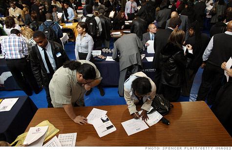 Americans filing for unemployment benefits falls by 1,000, as closely watched reading shows modest improvement.