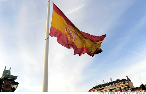 The rating agency also downgraded four Spanish regions, two of them to junk.