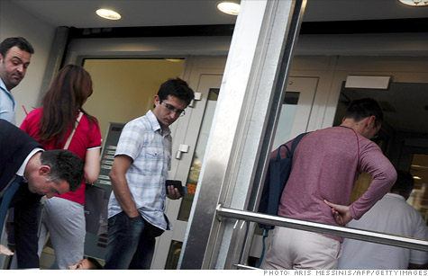 Bank customers in Greece, lining up recently at an ATM, have made widespread withdrawals of cash.