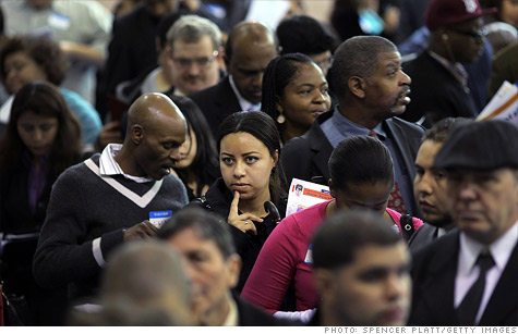 People wait in line at a job fair in Queens, New York.