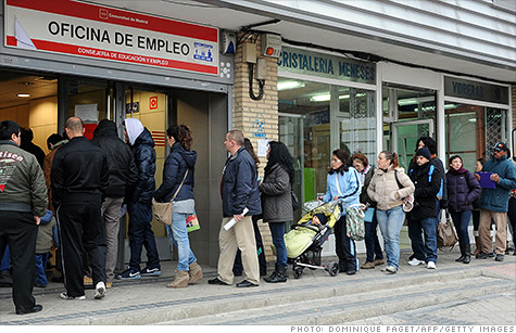 People wait on line at a government unemployment office in a Madrid suburb. Spain had the highest unemployment rate in Europe in April.