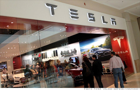 Tesla's shopping mall stores are expected to get more traffic than traditional dealerships but could face legal challenges.