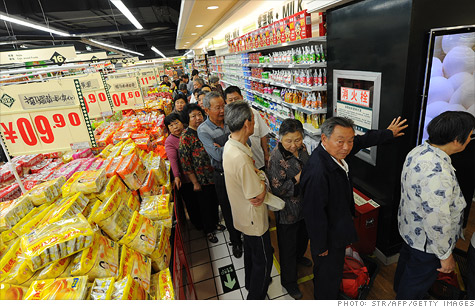Chinese shoppers lining up to buy discounted eggs at a supermarket.