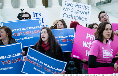 Supporters and opponents of the health reform law rallied in front of the Supreme Court in March.