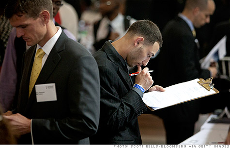 A job seeker fills out an application at the Veterans On Wall Street job fair in New York.
