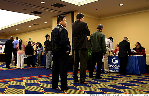 Job seekers attend a career fair in San Francisco. Unemployment claims rose last week.