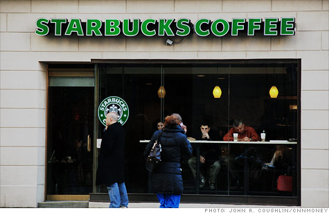 Starbucks shares were trading lower after the coffee giant lowered its outlook.