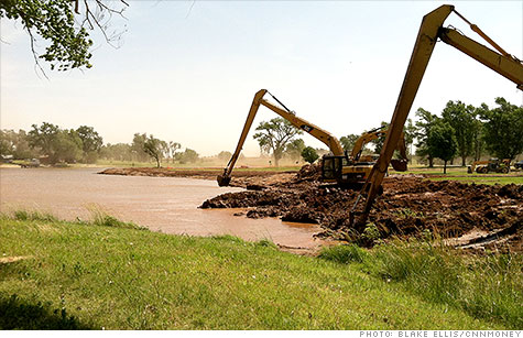 Excavators prepare water for the oil industry in Kansas. The drought is restricting water available for fracking, which could harm U.S. oil production.