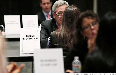 Job seekers meet with recruiteres at a career fair in New York earlier this week.